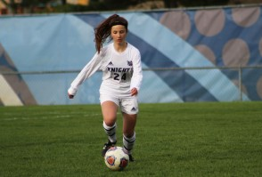 Freshman defender Addy Alexopoulos brings the ball up field for the Knights.