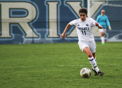 Senior midfielder Maria Egloff brings the ball into the offensive zone.
