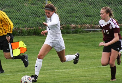 Sophomore forward Olivia Boblet runs around a Kalamazoo Central defender.