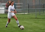 Freshman forward Nia Alexopoulos carries the ball up field to a very busy Knights offensive unit.