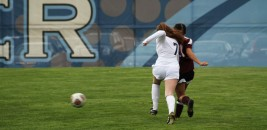 Freshman defender Emma Scheele boxes out a Kalamazoo Central forward in order to make a clean play on the ball.