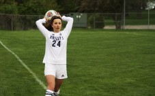 Freshman defender Addy Alexopoulos inbounds the ball. Addy is one of two sets of twins on the women's varsity team.