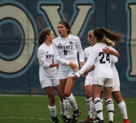 The Knights celebrate after a goal scored by sophomore forward Olivia Boblet. Boblet finished the night with one goal and one assist.