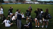 Coach John Mckenzie addresses the team post-game, before releasing the team to see their fans.
