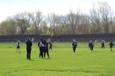 The Women's Kalamazoo United Lacrosse team practices before their next game. They lost both games that day.