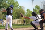 Senior catcher Griffin Conley catches the ball after a swing and a miss from a Kalamazoo Home School batter. Senior Nathaniel Roberts closed out the game from the pitcher's mound.