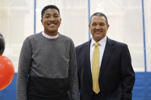 "Tony Dennis poses with Principal Rodney Prewitt, Dennis will continue to play soccer at Lake Michigan College. ""It's a community college so its like a small start and I can build up my academics and hopefully transfer somewhere else bigger afterward,"" said Dennis. Photo Credit / Griffin Conley"