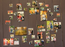 Photos are hung along the wall showing some of the work done by Open Roads.