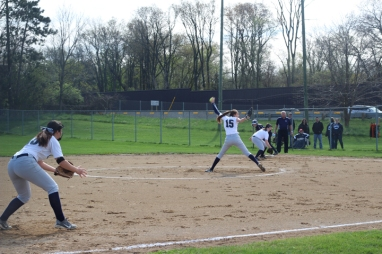 Junior Jessica Boer pitches the ball. Varsity Softball ended up losing the game against Comstock High School that day.