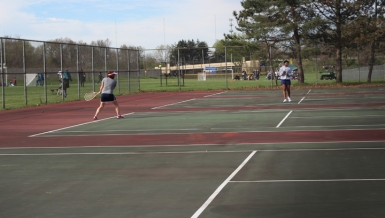 Senior Grace Augustine plays her hardest in the first match of the day. she ended up losing the match that day.