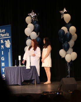 Junior and Senior class representatives Alina Offerman and Madelyn Skyles take on the tradition of lighting the candle. This ensures the graduating class good luck for their futures. Photo Credit / Izze Fahl
