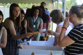 Seniors wait in line to recieve their awards on paper. These will be awards that they can remember their high school career. Photo Credit / Bill Bowser