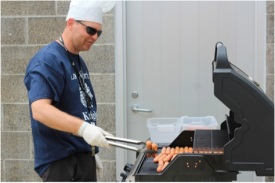 Health teacher Richard Labadie helped prepare all the food for the Academic Pep Assembly. He spent 3 hours cooking hotdogs for the students so they could eat and enjoy their time at the assembly. Photo Credit / Josh Hentkowski