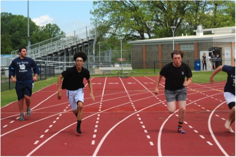 Delvin Swift (black shirt on left) races Zack Sims (on right) at the Academic Pep Assembly to pass time. Before the race, Zack bragged and bet the other racers he could beat them. Photo Credit / Josh Hentkowski