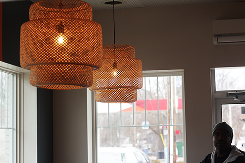 The decor in Nonla Burger is retro with a modern twist. Co-owner Natasha Monk chose these light fixtures because she believed they represented a mix of modern and old. Photo Credit / Abigail Lindblade