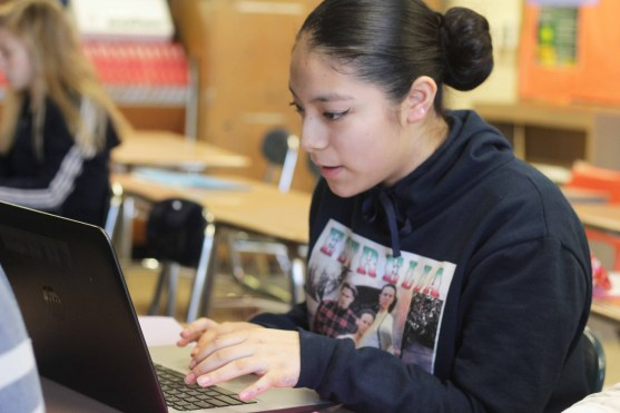 "Freshman Estrella Saavedra typed her letter to a representative. Saavedra said, ""I think they should put more attention on gun laws and gun control."" Photo Credit / Grace Marshall"