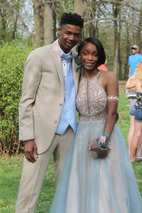 "Senior Nuru Lewis stunned the crowd as she and junior De'Andre Worthy switched from their normal sports apparel to their blue and pink prom attire. ""I traveled so much for this dress but, little did I know, it was at David's Bridal and as soon as I put it on I knew it was the one that would shock everyone,"" said Lewis."