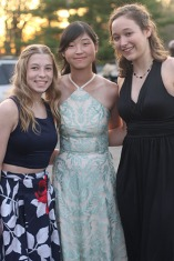 "Seniors Molly Ratliff, Mey Wong, and Abby Guimond pose together for a picture. Many students met at Crane Park for pictures then parted ways for dinner. ""I liked getting to go to Maru's Sushi and Grill with friends and hanging with them while we danced the night away,"" said Wong."