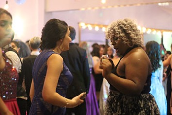 "Senior Australia Smith compliments fellow senior Amarra Lyon's dress on the dancefloor. Prom is a great opportunity to see the senior and junior class interact. ""I liked catching up with old friends who I don't get to see as much."