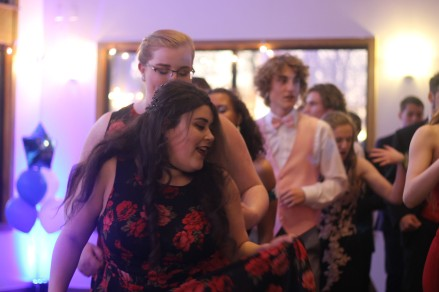 "Senior Blaise Boulding dances with junior Olivia Jones. The dance floor was filled with people dancing, singing, and cha-cha-sliding. ""Olivia and Izzy Wikle were my two favorite [to dance with] because they actually just wanted to have fun."" said Boulding."