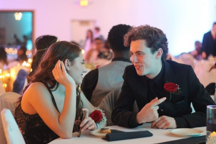 "Senior Alex Vonhof sits with girlfriend Daryn Dratt. The two attend KAMSC together but have different home schools. ""It's nice to be able to go to two different proms but the one with your friends is typically the best,"" said Vonhof."