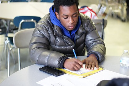 Freshman Yahweh Johnson studies with his Link leader. It can be tough to find time to study between school and afterschool activities, but the Snack and Study gives students a safe and calm environment to be productive.