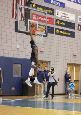 Senior Nmesomachi Nnebedum attempts to dunk the basketball at the pep assembly. He is both a point and shooting guard on the basketball team.