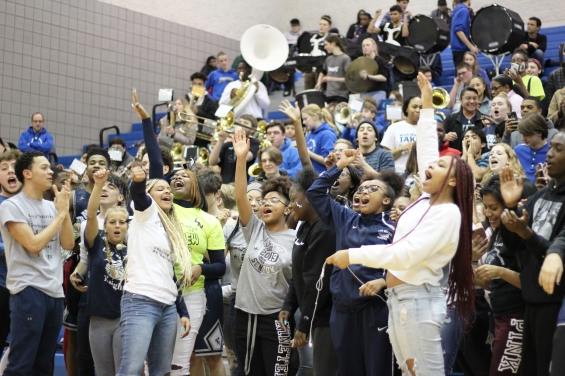 LN's senior section screams the school fight song trying to beat the other classes at being the loudest. Seniors won the contest.