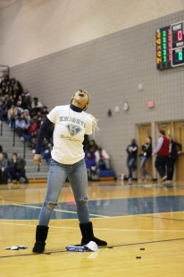 Senior Imani Berry attempts to get as many Oreos in her mouth as she can while competing against the other classes. Junior Derrell Mabon ended up winning the contest.